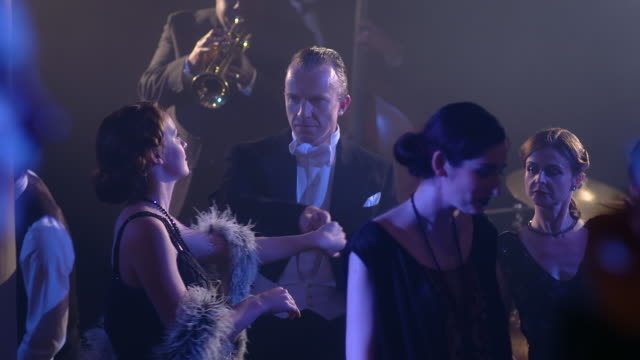 ms pan slo mo view of edward viii and others dancing with band in background / new york, united states - 舞踏会点の映像素材/bロール
