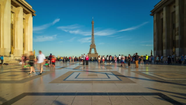 view of eiffel tower from trocadero with crowds of tourists - 4k time-lapse - eiffel tower stock videos & royalty-free footage
