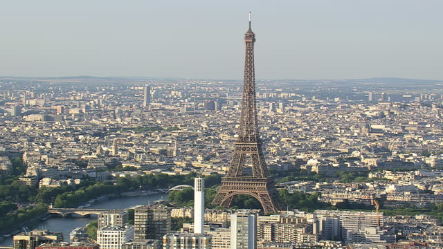 ws aerial view of eiffel tower in city / paris, france - eiffel tower stock videos & royalty-free footage