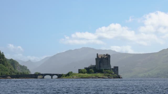 view of eilean donan castle in scotland - castle stock videos & royalty-free footage