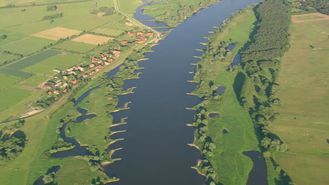 WS AERIAL ZI View of Elbe river with houses and farmland at border along Elke / Germany