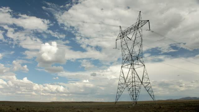 ws pan t/l view of electric pylon in field against sky / flagstaff, arizona, usa - flagstaff arizona video stock e b–roll