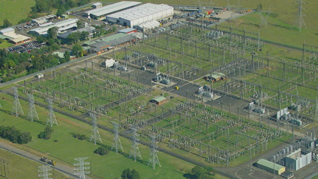 ms aerial ds zo view of electrical poles in small power station surrounded by trees / sydney, new south wales, australia - power equipment stock videos & royalty-free footage