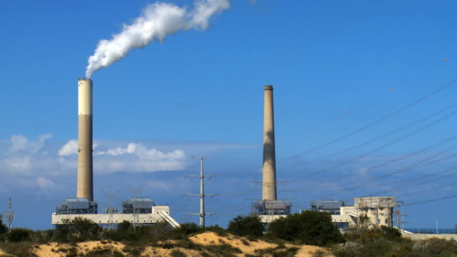 WS View of electricity Power Station with chimneys emitting steam / Ashkelon, Judea, Israel