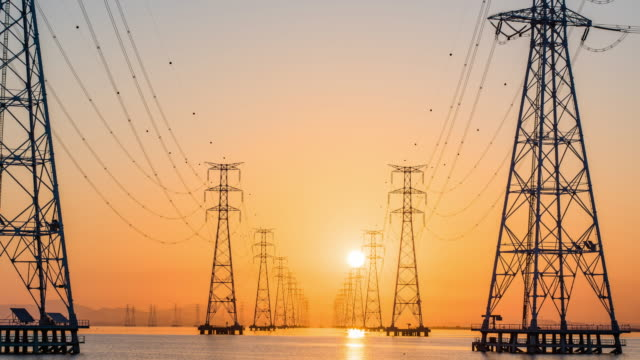 view of electricity pylon at sihwaho lake near sihwa lake tidal power station (the world's largest tidal power installation) at sunrise - power line stock videos & royalty-free footage