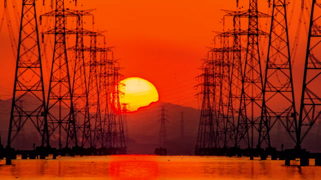 view of electricity pylon at sihwaho lake near sihwa lake tidal power station (the world's largest tidal power installation) at sunrise - strom stock-videos und b-roll-filmmaterial