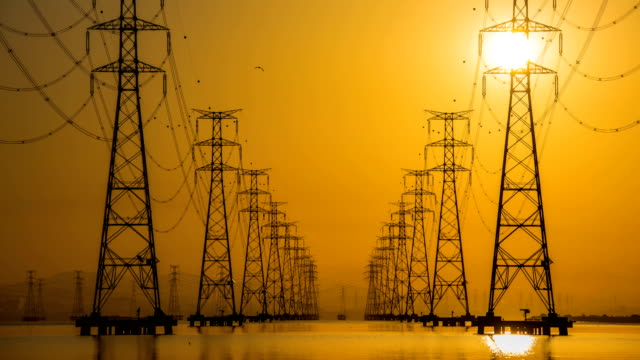 View of electricity pylon at Sihwaho lake near Sihwa Lake Tidal Power Station (The world's largest tidal power installation) at sunrise
