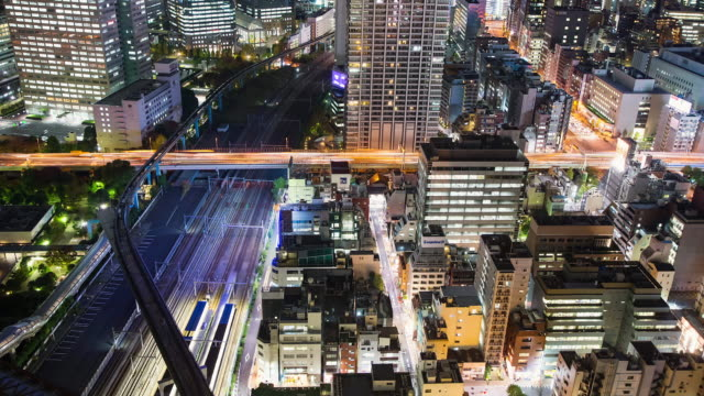 WS T/L View of elevated highway and train traffic in hamamatsucho at night / Tokyo, Japan