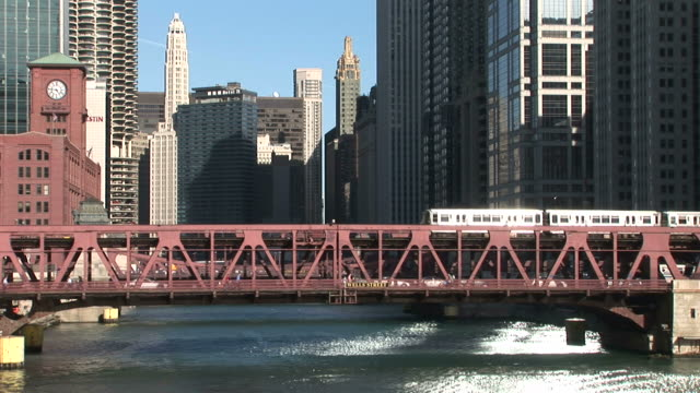 view of elevated train passing through bridge in chicago united states - chicago elevated stock-videos und b-roll-filmmaterial