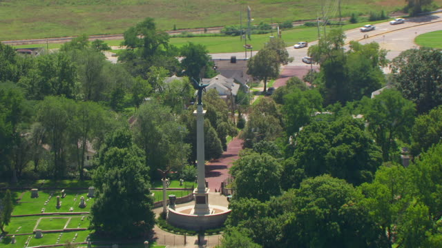 WS ZO AERIAL POV View of Elijah P. Lovejoy Monument and cemetery with Mississippi River in background/ Alton, Illinois, United States