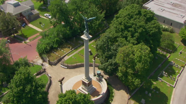 WS AERIAL POV View of Elijah P. Lovejoy Monument and cemetery with Mississippi River in background/ Alton, Illinois, United States