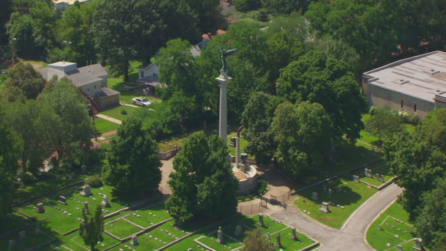 WS AERIAL POV View of Elijah P. Lovejoy Monument with cemetery / Alton, Illinois, United States
