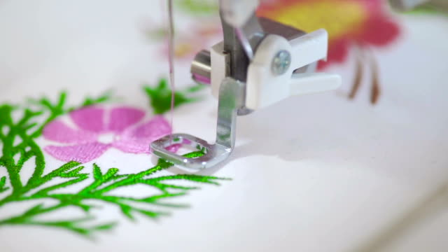 view of embroidering flowers with sewing machine. - embroidery stock videos & royalty-free footage