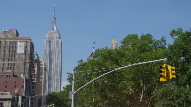 WS View of Empire State Building from street / New York, United States
