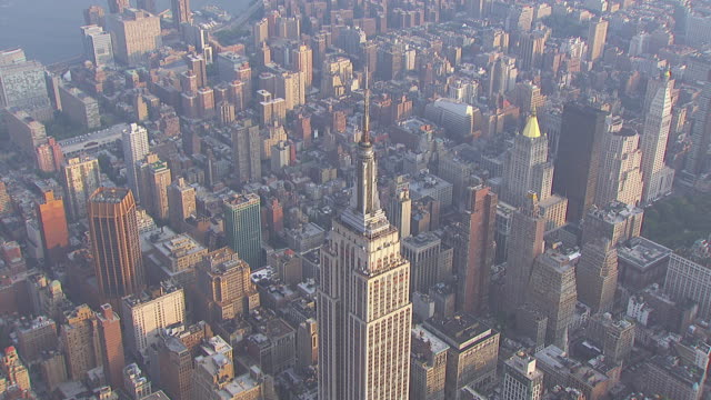 ws aerial view of empire state building in city / new york, united states - empire state building stock videos & royalty-free footage