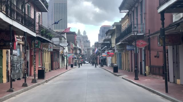 view of empty bourbon street in the french quarter amid the coronavirus pandemic on march 27, 2020 in new orleans, louisiana. orleans parish has... - new orleans stock videos & royalty-free footage