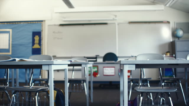 ms pan view of empty classroom / edmonds, washington, usa - abwesenheit stock-videos und b-roll-filmmaterial