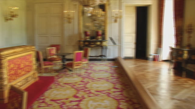 ws pan view of empty king's room interior / versailles, ile de france, france - chateau de versailles stock videos and b-roll footage