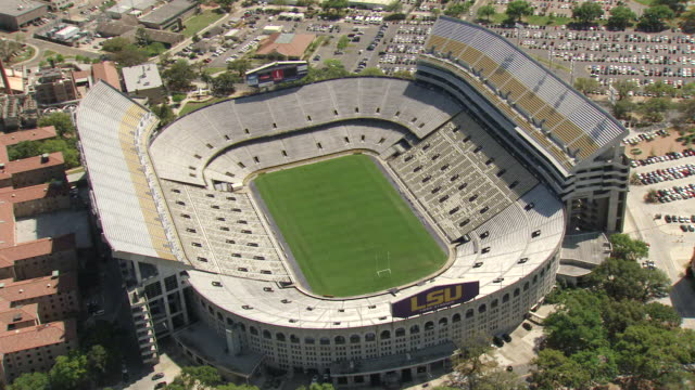 ws aerial view of empty louisiana state university tiger stadium and bleachers / baton rouge, louisiana, united states - baton rouge stock-videos und b-roll-filmmaterial