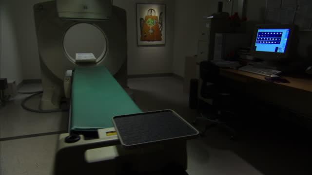 ms ds view of empty scan room with dramatic lighting / burlington, vermont, usa  - burlington vermont bildbanksvideor och videomaterial från bakom kulisserna