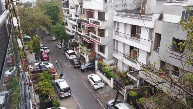 view of empty streets and sounds of animals and birdsat a residential area of south delhi during the nation wide lockdown declared by the government in india for entire 1.3 billion population - indian politics stock videos & royalty-free footage