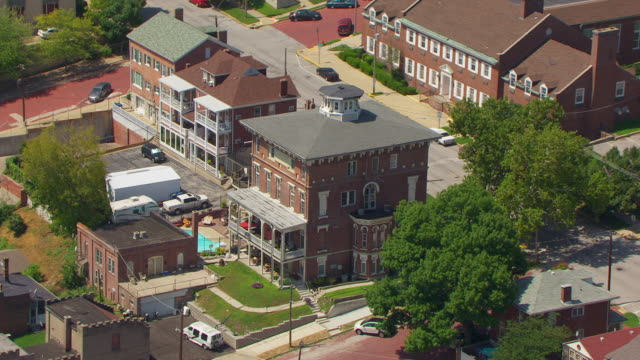 WS AERIAL POV View of Enos Apartment Building in city / Alton, Illinois, United States