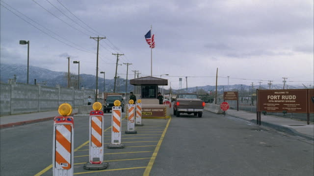 ws view of entrance gate of fort rudd, vehicles entering and exiting - military base stock videos & royalty-free footage