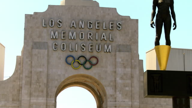 ws zo view of entrance of los angeles memorial coliseum home of the 1932 and 1984 summer olympics and home of usc trojans football team / los angeles, california, usa  - the olympic games stock videos & royalty-free footage
