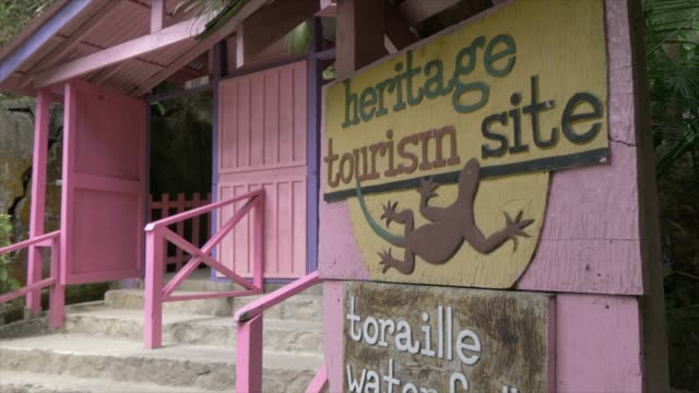 view of entrance sign to toraille waterfall, st. lucia, windward islands, west indies caribbean, central america - st. lucia stock videos & royalty-free footage