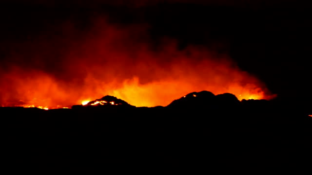 view of erta ale volcanic activity (active basaltic shield volcano) and smoke - ale stock videos & royalty-free footage