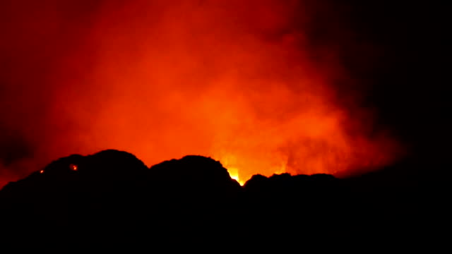 view of erta ale volcanic activity (active basaltic shield volcano) with flame and smoke - ale stock videos & royalty-free footage