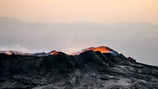 view of erta ale volcanic (active basaltic shield volcano) with flame and smoke - shield stock videos & royalty-free footage