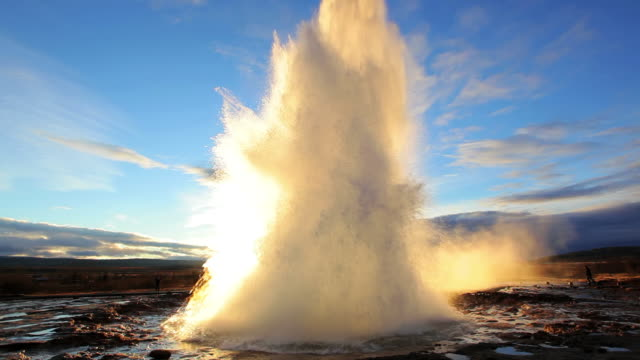 WS View of erupting Geyser Strokkur at sunset / Iceland