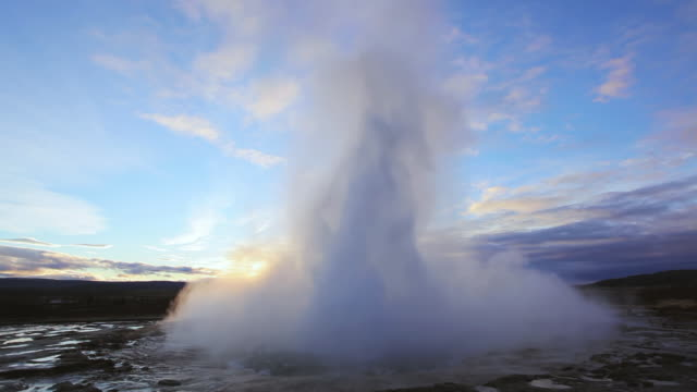 ws view of erupting geyser strokkur / iceland - geyser stock videos and b-roll footage