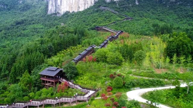 view of escalator in grandcanyonscenicspotinenshi,hubei,china. - footpath stock videos & royalty-free footage
