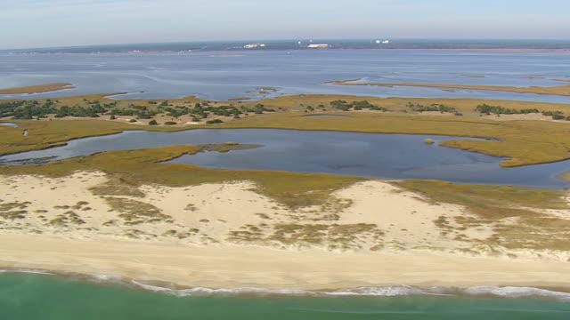 ms aerial view of estuary with coast / north carolina, united states - north carolina beach stock videos & royalty-free footage