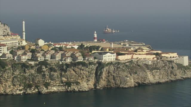 ws zi aerial view of europa point with cityscape / gibraltar city, gibraltar, spain  - gibraltar bildbanksvideor och videomaterial från bakom kulisserna