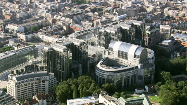 ms aerial zi view of european parliament in city / brussels, belgium - regione di bruxelles capitale video stock e b–roll