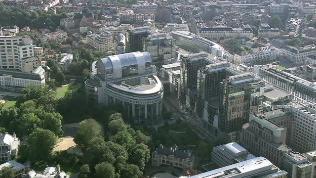 ms aerial zi zo ts view of european parliament in city / brussels, belgium - regione di bruxelles capitale video stock e b–roll