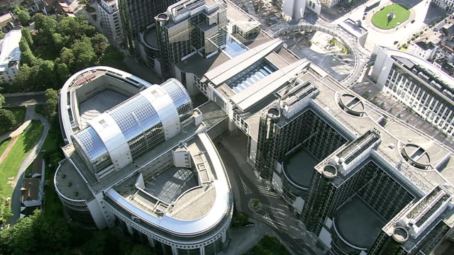 ms aerial ts view of european parliament in city / brussels, belgium - regione di bruxelles capitale video stock e b–roll