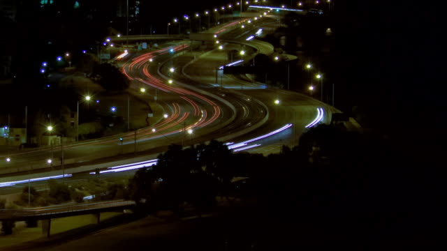 WS PAN T/L View of evening traffic lights on motorway / Sydney, New South Wales, Australia