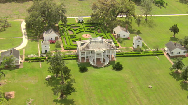WS AERIAL View of evergreen plantation building and gardens / Louisiana, United States