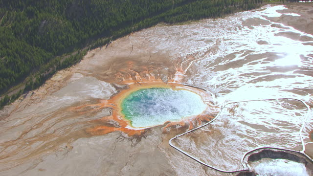 WS AERIAL TS ZO View of Excelsior Geyser Crater and Grand Prismatic Spring at Yellowstone National Park / Wyoming, United States