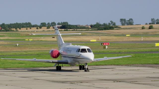 ws aerial view of executive jet at roskilde airport / sjaelland, denmark - oresund region stock videos & royalty-free footage