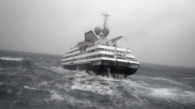 ws pov view of expedition ship sailing through large sea waves / drake passage, antarctica - drake passage stock videos and b-roll footage