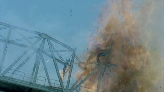 ms view of explosion of truck on steel girder bridge - girder stock videos & royalty-free footage