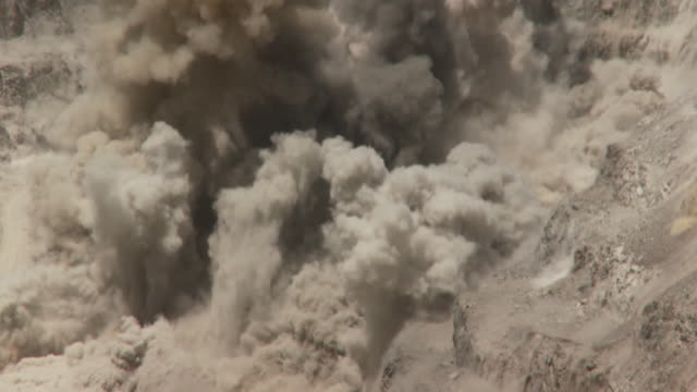 ws view of explosion on opencast mine / namibia - miniera video stock e b–roll