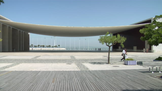 ws view of expo with tejo river in background / lisbon, portugal - pavilion video stock e b–roll