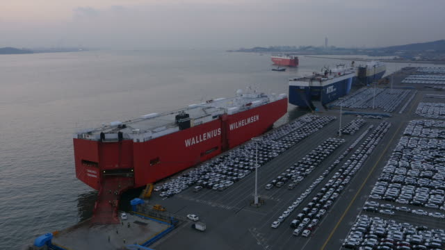 view of export pier with large group of cars parking in a row at pyeongtaek port - shipping stock videos & royalty-free footage