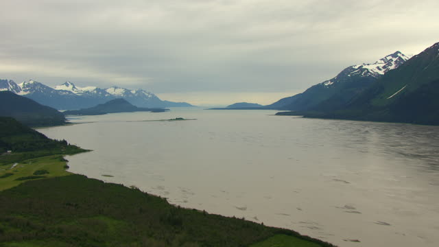 ws aerial view of facing south to chilkat inlet shoreline / alaska, united states - inlet stock videos & royalty-free footage
